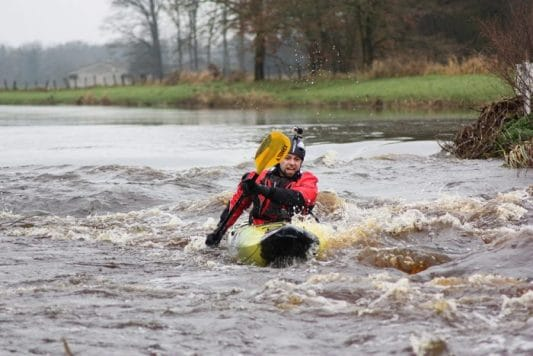 First whitewater kayaking steps of a kayak angler